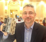 HP's Juan Igancio Calderon shows off a PageWide printhead for large format printers at HP Discover