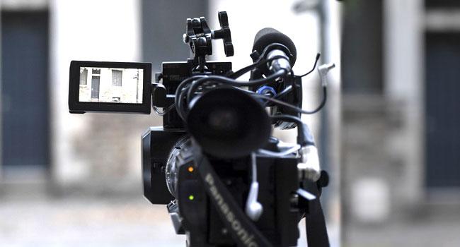 Journalist Camera - Indonesian police arrest suspects in murder of journalist, activist