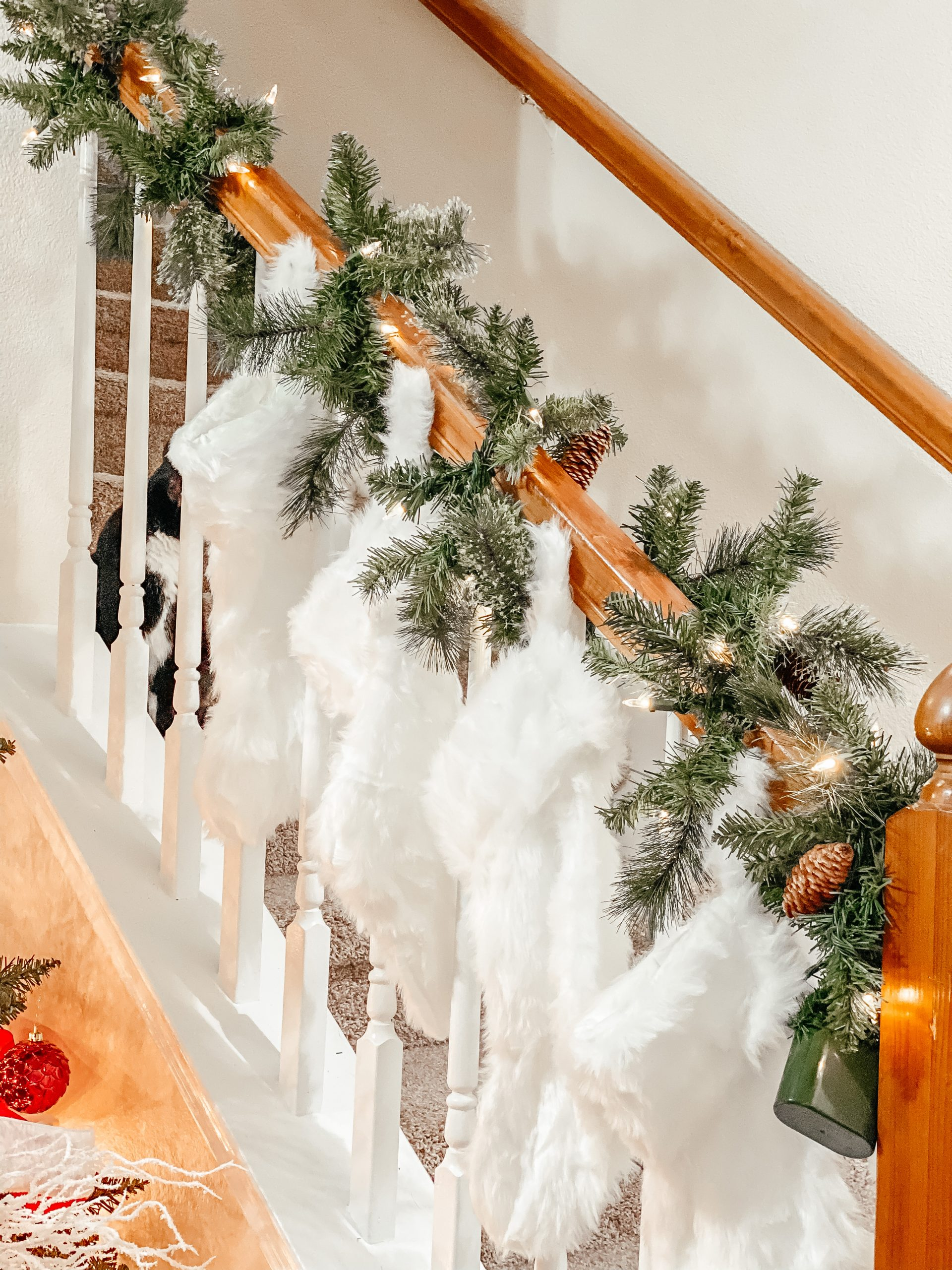 Christmas stockings and garland on banister