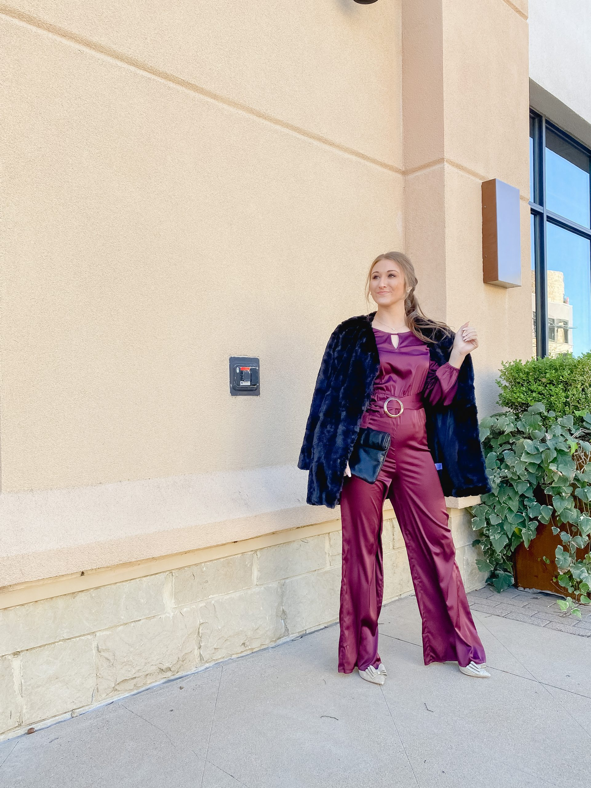 Satin jumpsuit from Red Dress Boutique, black faux fur coat and black clutch - outfit for the holidays \\ outfit for NYE