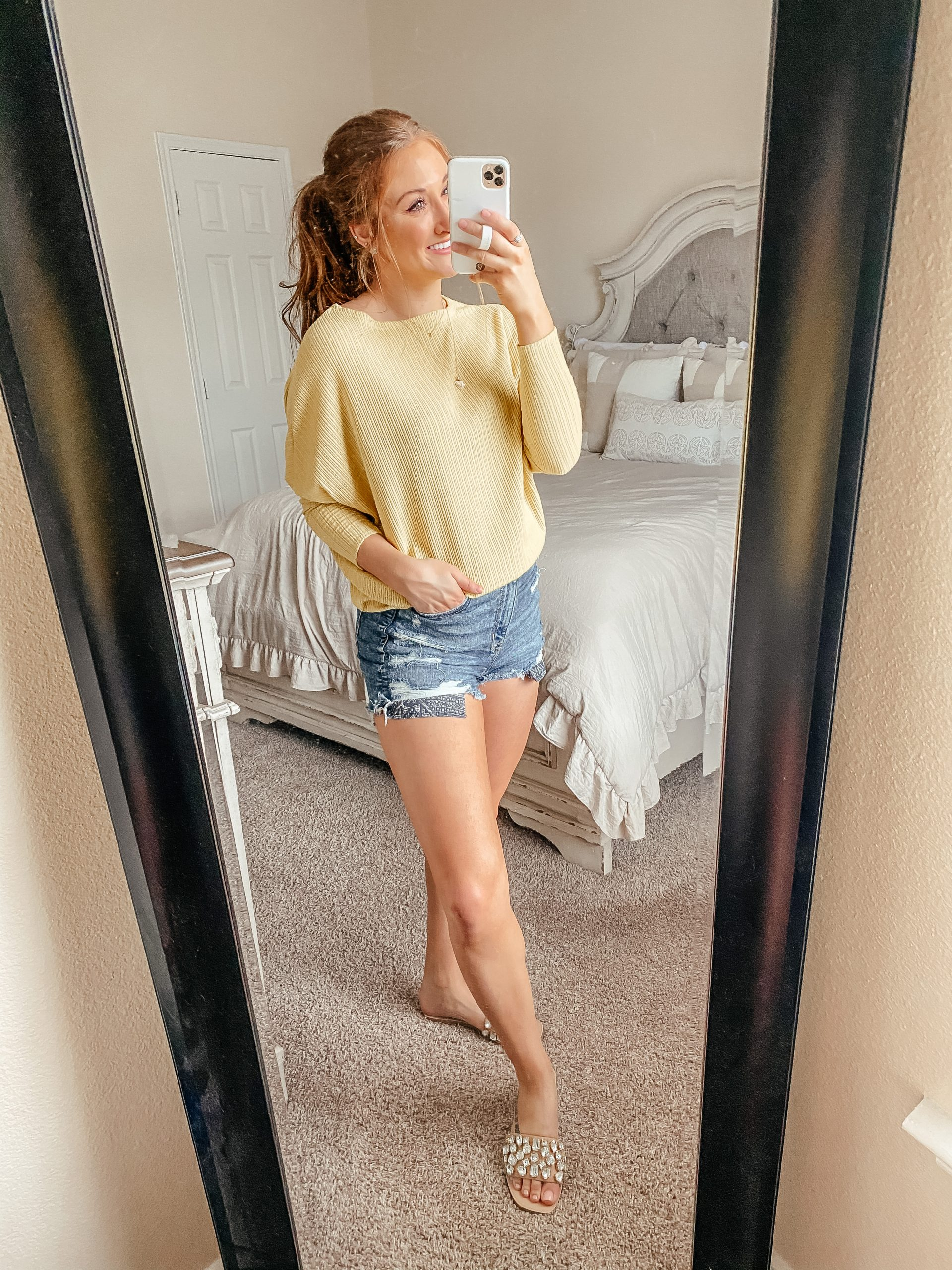 Yellow slouchy sweater from Red Dress Boutique and high-waisted denim shorts from American Eagle.