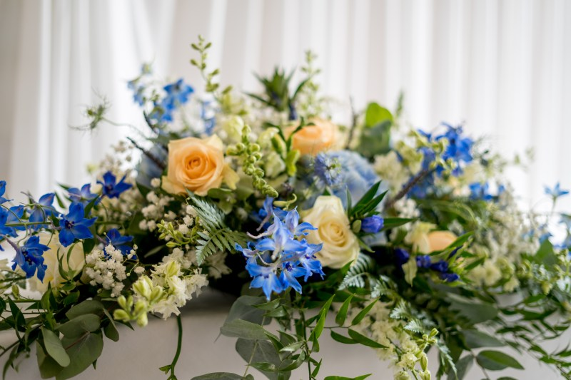 Flowers in the wedding ceremony room at Belton Woods Hotel.