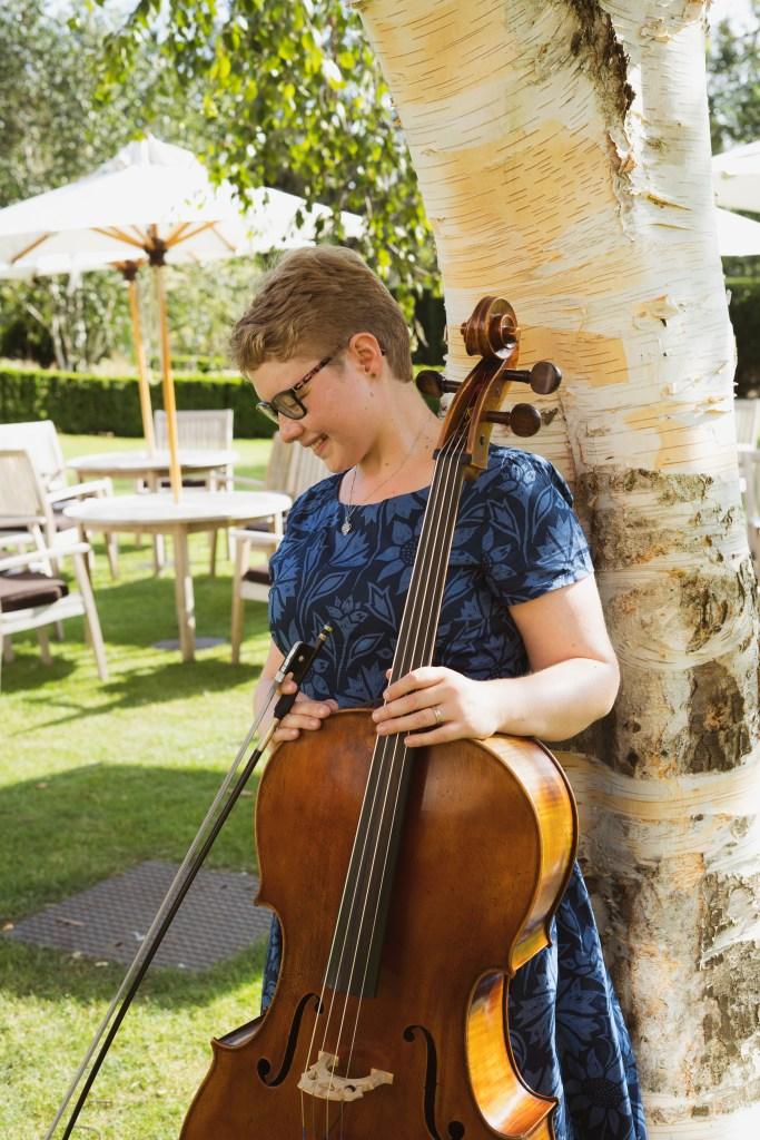 Cellist Sarah James in a dress from seasalt.