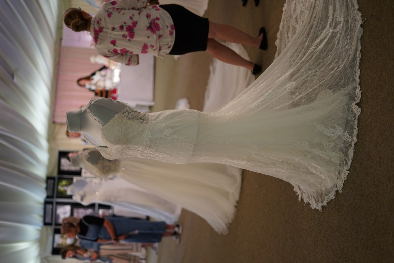 wedding dresses at wedding fair full length.
