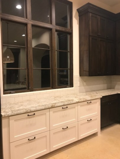 Semi-full overlay with shaker fronts.