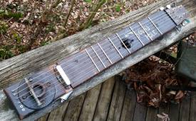 The frets are large bamboo skewers.