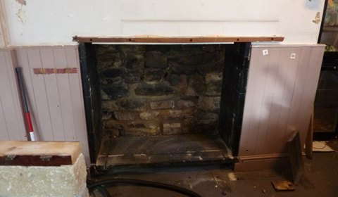 We uncovered a lovely fireplace.