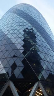 The many reflections on the Gherkins glass facade. .
