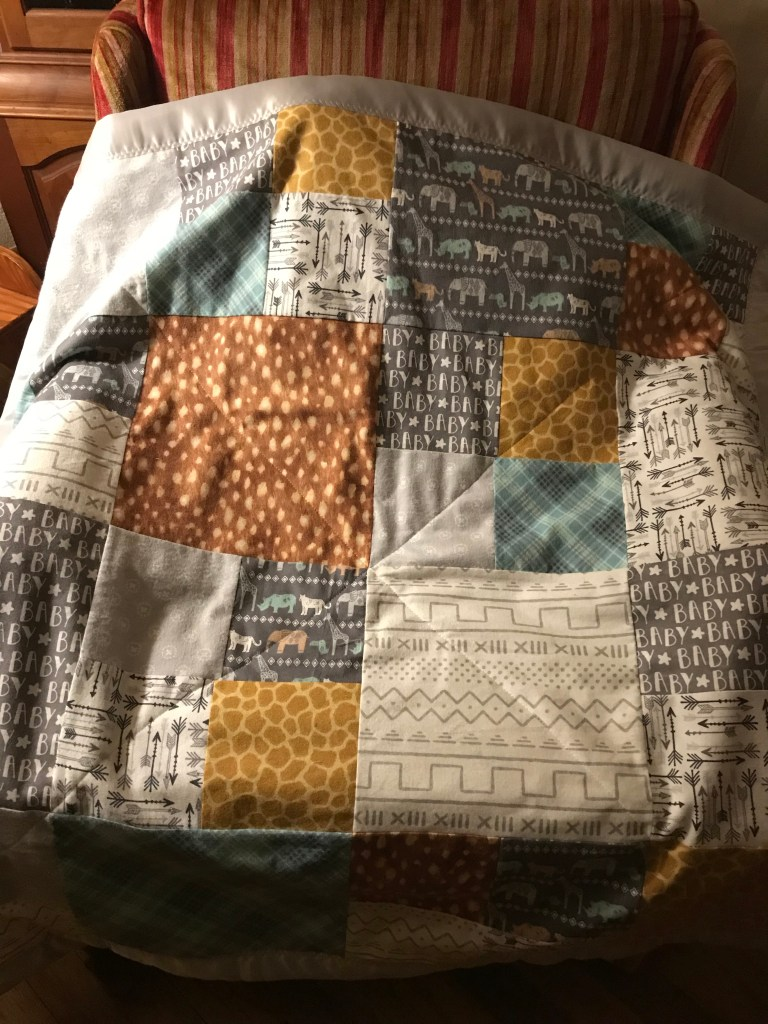 This quilt didn't exactly come together like I'd planned.  I had to make a few changes and be flexible.