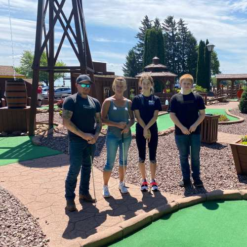 Family on the Mini-Golf Course