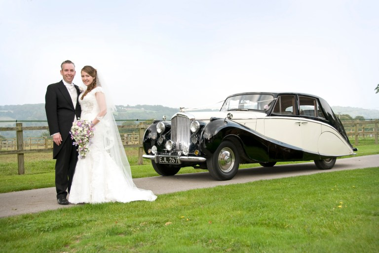 1952 Bentley with happy couple - ideally wedding car