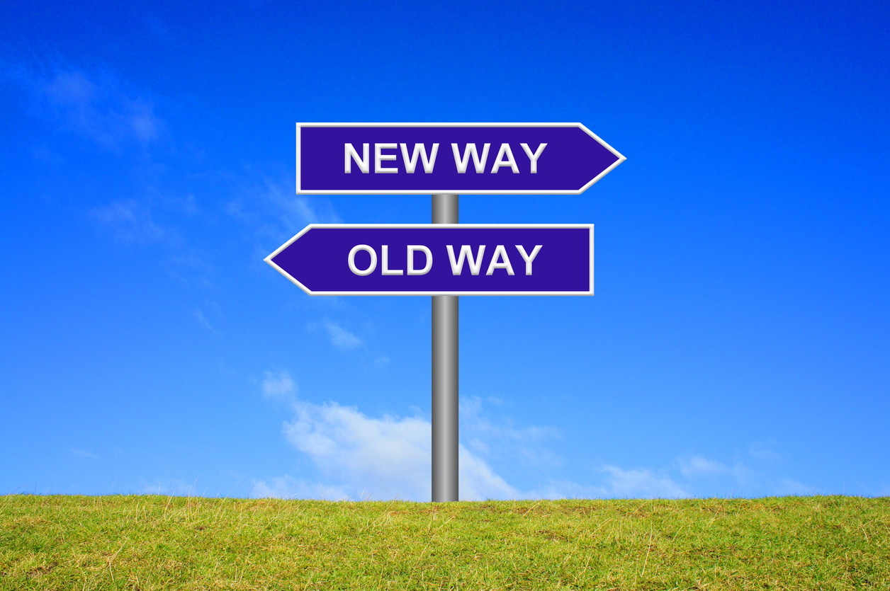 Signpost Showing New Way Old Way