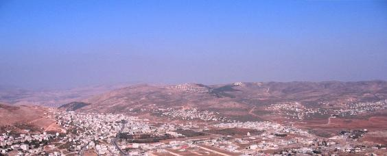 Elon Moreh (Plain of Moreh) panorama. Located in proximity to the small mountain at the center on the horizon, Elon Moreh is an Israeli town located in the Samarian hills on the slopes of the Mount Kabir Ridge.