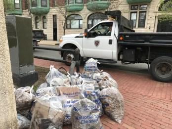 DCR picking up bags of trash