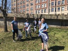 Student volunteers picking up trash
