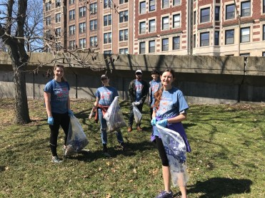 Student volunteers picking up trash