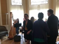 Harpist and guests at the Charlesgate in Bloom Fundraiser and Cocktail Party