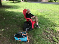 A Guest Sitting in a Temporary Red Chair