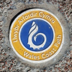 Ceramic plaque of the Wales Coast Path. Photograph by Charles Hawes