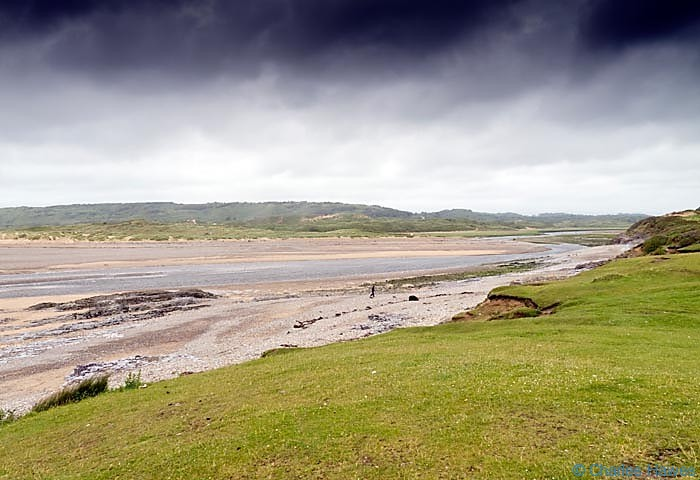 Mouth of the Ogmore River photographed from the wales Coast path by Charles Hawes. Walking in Wales.