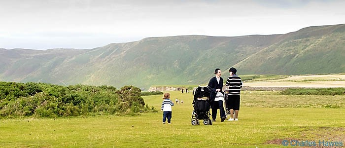 Hassidic family at Rhossili on the Wales Coast Path between Pennard Burrows and Rhossili photographed by Charles Hawes. Walking in Wales.