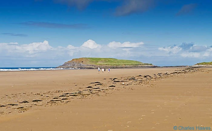 Burry Holm and Rhossili beach between Rhossili and Llanrhidian on the Wales Coast Path, photographed by Charles Hawes. Walking in Wales.