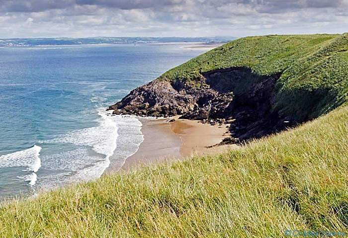 View from the top of the dunes towards the Loughor Estury taken from The Wales Coast path between Rhossili and Llanrhidian, photographed by Charles Hawes. Walking in Wales.