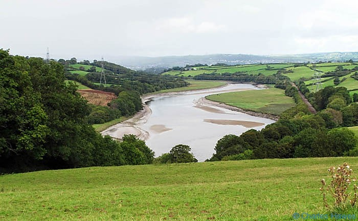 Towy valler and river viewed from the Wales Coast Path between Kidwelly and Carmarthen, photographed by Charles Hawes. Walking in Wales.