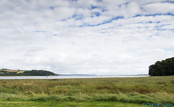 The Estuary at Laugharne photographed from the Wales Coast Path between St Clears and Amroth by Charles Hawes. Walking in Wales.