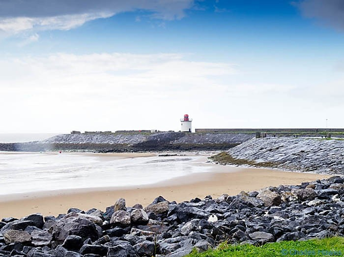 Burry Port Lighthouse photographed on The Wales Coast path between Llanelli and Kidwelly by Charles Hawes. Walking in Wales.