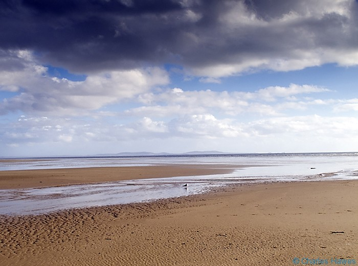 Pendine Sands photographed from the Wales Coast Path between St Clears and Amroth by Charles Hawes. Walking in Wales.