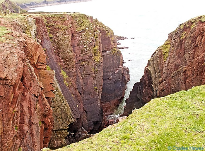 Dramatic cliffs on the Wales Coast path, Pembrokeshire, near Angle, photographed by Charles Hawes