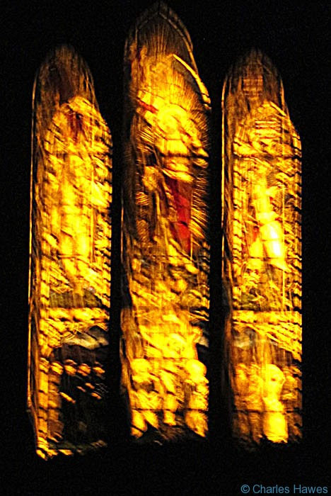 The stained glass in St James Church, Manorbier, Pembrokeshire, on the Wales Coast Path, photographed by Charles Hawes