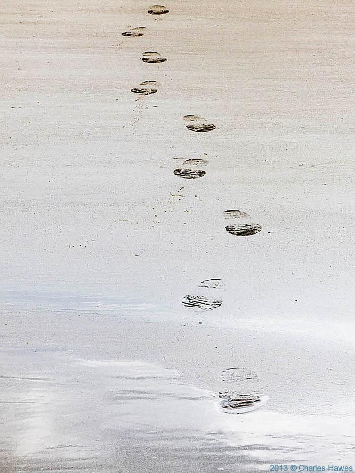 Footsteps on the beach at Newgale sands, Pembrokeshire, photographed by Charles Hawes
