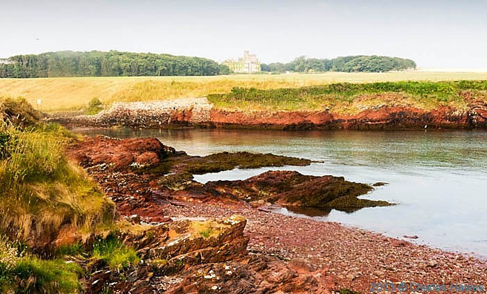 View across St Brides Haven to St Brides Castle from The Wales Coast Path, photographed by Charles Hawes