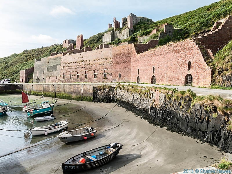Brick retaining walls of stone holding area at Porthgain, photographed by Charles Hawes