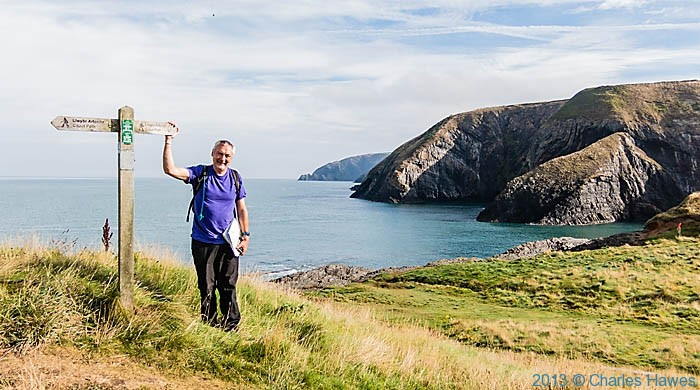 Charles Hawes at the finger post on the Pembrokeshire Coast path near Moylegrove