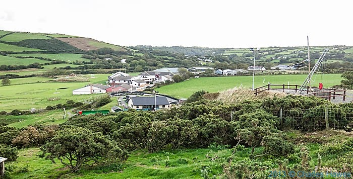 View of Urdd complex, photographed from The Wales Coast Path in Ceredigion by Charles Hawes