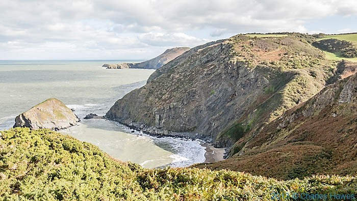 Bay between Penbryn and Llangrannog on The Wales Coast Path in Ceredigion, photographed by Charles Hawes