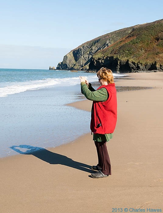 Anne Wareham on Penbryn Beach, photographed by Charles Hawes