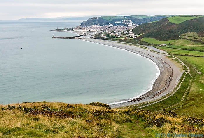 View onto Tanybwlch beach and Aberystwyth, photographed from The Wales Coast Path by Charles Hawes