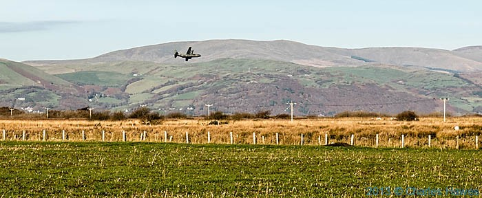 Low flying military plane in the Dyfi Valley, photographed from The wales Coast path by Charles Hawes