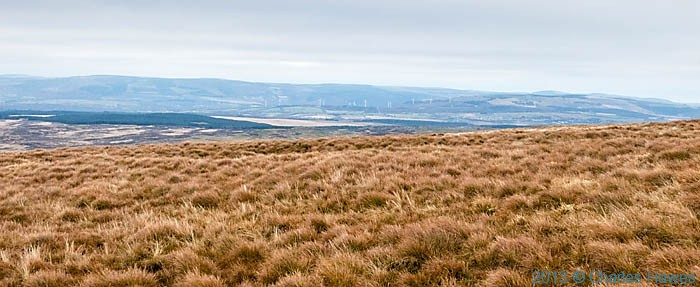Wind turbine installations viewed from Fan Gyhirych in the Brecon Beacons, photographed by Charles Hawes