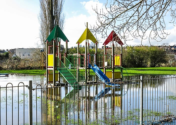 Flooded playground in Salisbury, photographed by Charles Hawes