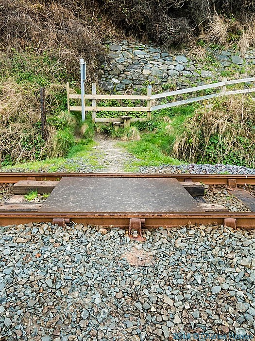 The Wales Coast Path crossing the railway line near Llanfair, Gwynedd photographed by Charles Hawes