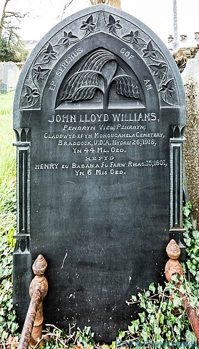 Headstone in churchyard in Penrhyndeudraeth, photographed from The Wales Coast Path by Charles Hawes