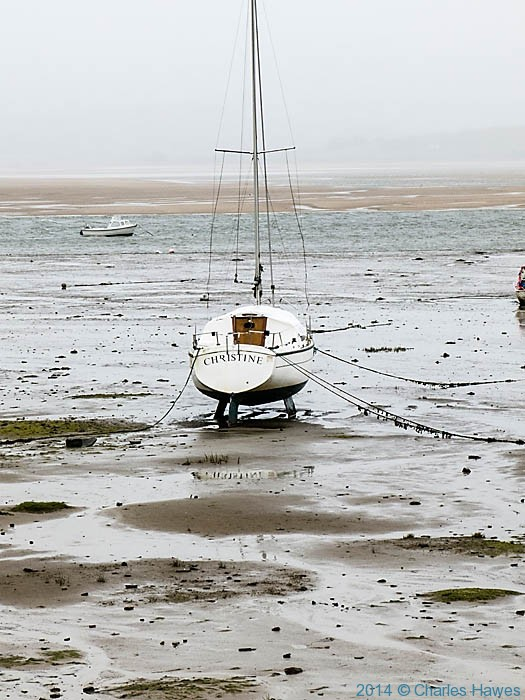 Sailing boat in the harbour at low tide at Borth-y-Gest near Porthmadog, photographed from The Wales Coast Path by Charles Hawes