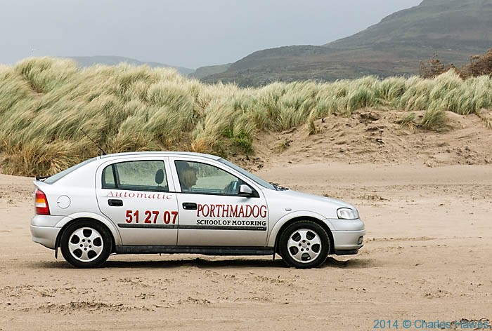 Car driving on Black Rock Sands, Lleyn peninsula, photographed from The Wales Coast Path by Charles Hawes
