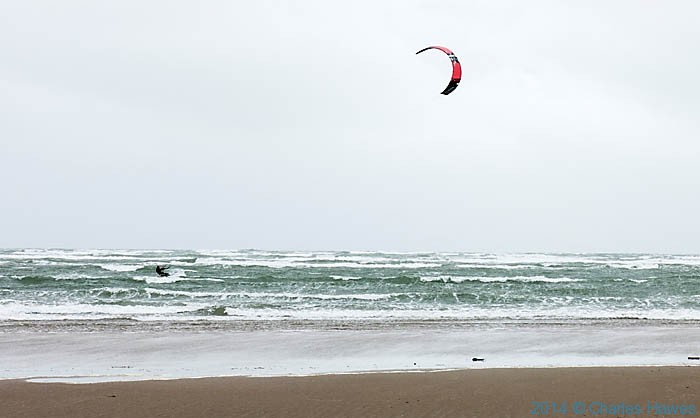 Kite-surfer at Black Rock Sands, Lleyn peninsula, photographed from The Wales Coast Path by Charles Hawes