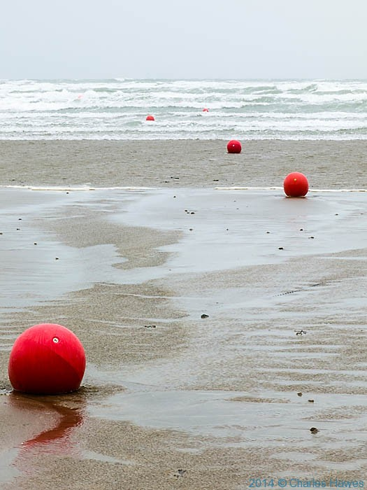 Buoys on the beach at Black Rock Sands, Lleyn peninsula, photographed from The Wales Coast Path by Charles Hawes